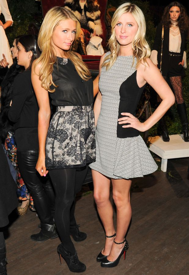 Paris Hilton and Nicky Hilton attend the Alice & Olivia autumn/winter 2014 presentation at New York Fashion Week - 10 February 2014