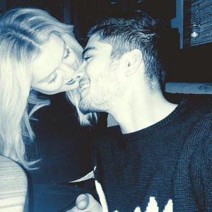 One Direction's Zayn Malik with fiancée Perrie Edwards on Valentine's Day (18 February).