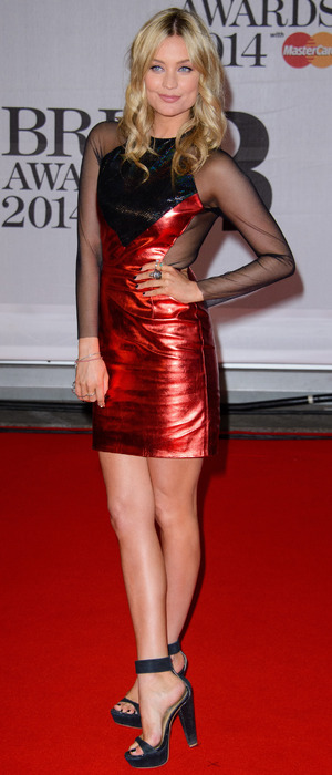 Laura Whitmore poses on the red carpet at the Brit Awards - London, 19 February 2014
