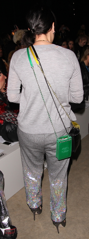 Back view of Lily Allen wearing three Chanel bags at once at the Ashish AW14 show at London Fashion Week - London, 17th February 2014