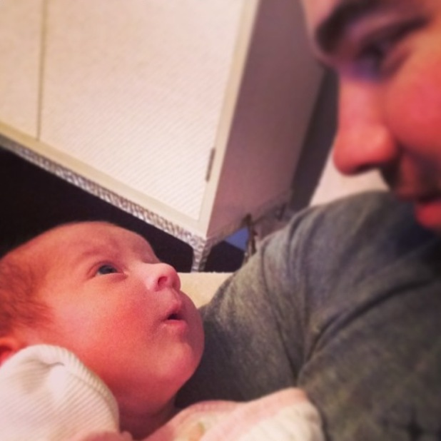 Kevin Jonas cradles baby daughter Alena Rose in new Instagram pic (17 February 2014).