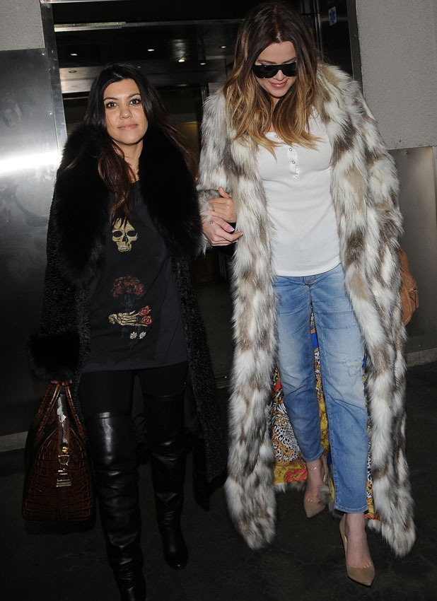 Khloe and Kourtney Kardashian arrive at Los Angeles International (LAX) airport, 17 February 2014