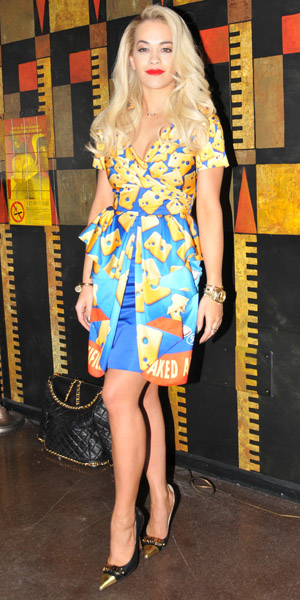 Rita Ora wears cheese-print dress at Milan Fashion Week on 20 February 2014