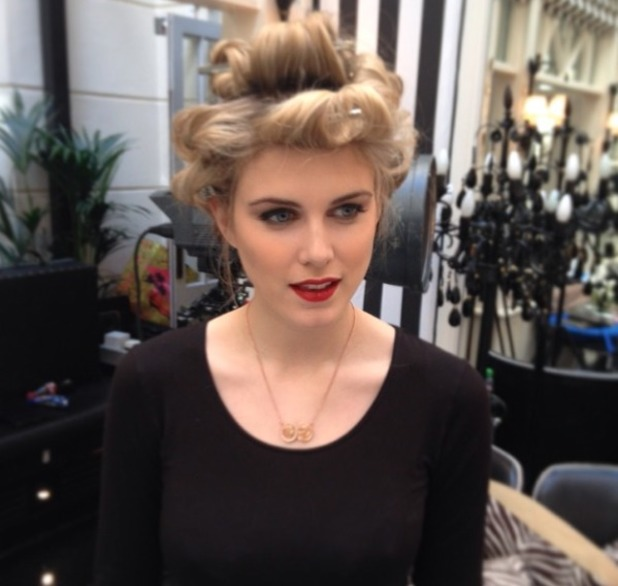 Ashley James, behind-the-scenes shot on a photo shoot with red glossy lips and hair in curlers, 24 February 2014