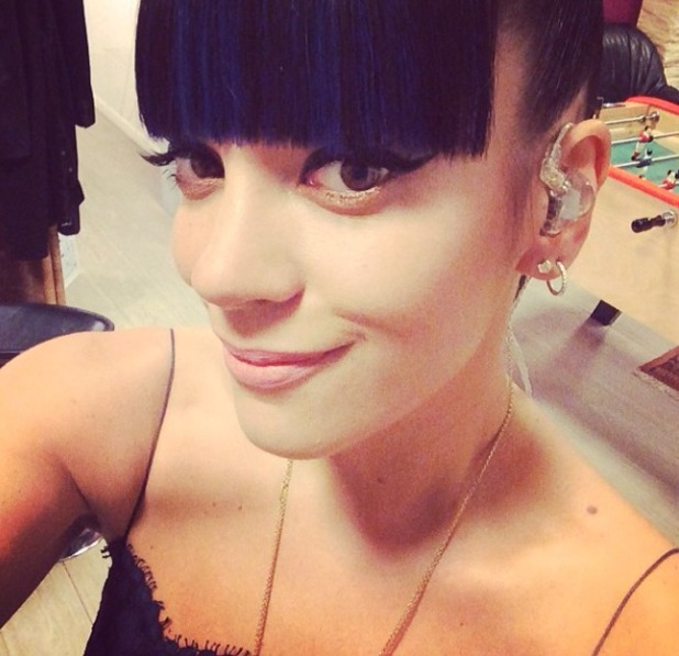 Lily Allen shows off her make-up, Paris, performing on Le Grand Journal, 25 February 2014