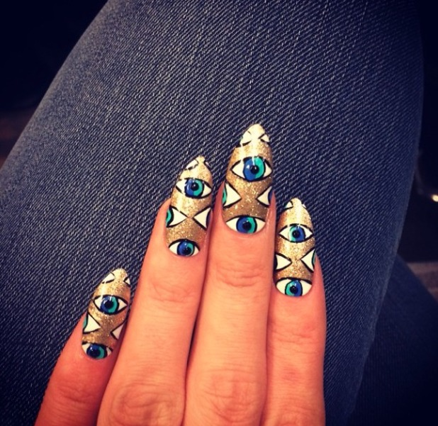 Lily Allen shows off her 'third eye' nails while in Paris to perform on Le Grand Journal, 25 February 2014