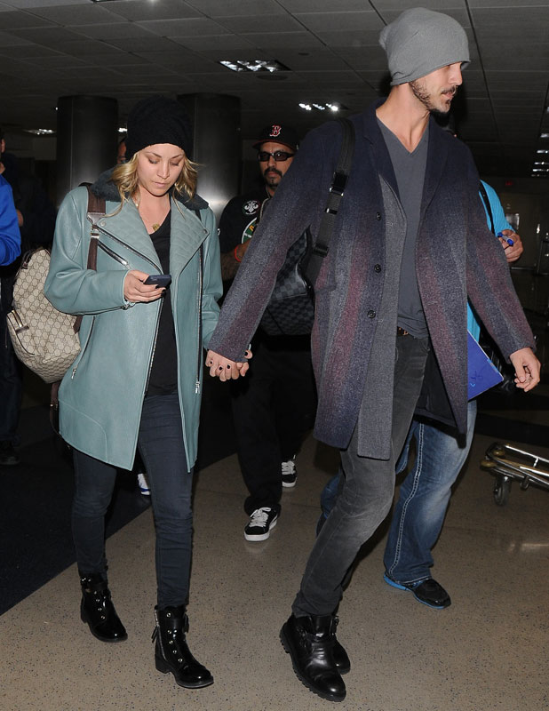 Kaley Cuoco and husband Ryan Sweeting at Los Angeles International Airport (LAX), 26 February 2014