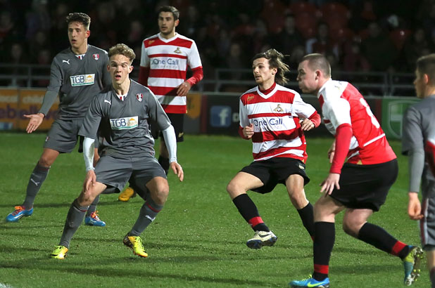 One Direction's Louis Tomlinson makes his Doncaster Rovers football debut at Keepmoat Stadium, 26 February 2014