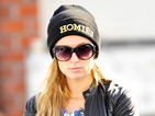Paris Hilton rocks 'Homiès' beanie hat while out with pet pooch Peter Pan