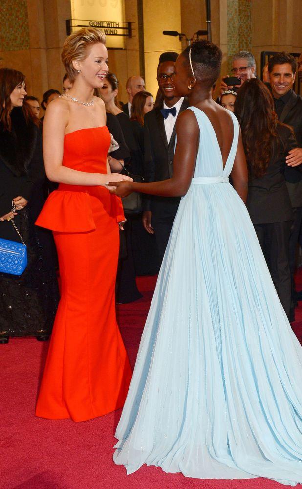 Jennifer Lawrence, Lupita Nyong'o, 86th Annual Academy Awards Oscars, Arrivals, Los Angeles, America - 02 Mar 2014