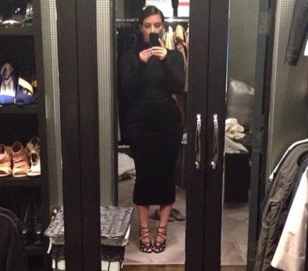 Kim Kardashian wears Tom Ford heels at home - 4 March 2014