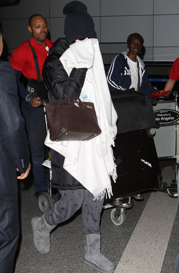 Katy Perry hides her face from the paps at Los Angeles International Airport (LAX), 5 March 2014