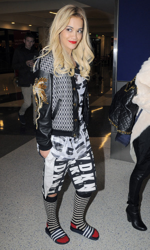 Rita Ora makes her way through LAX airport with a friend heading to New York City - 10.3.2014