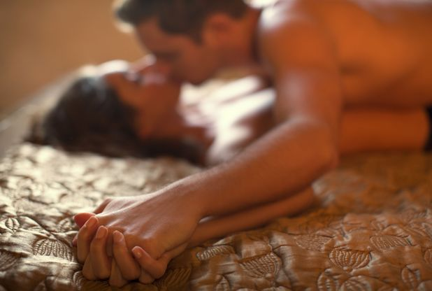 Couple kissing in bed for erotic fiction extract