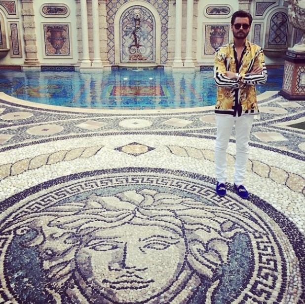 Scott Disick poses inside the Versace Mansion (13 March).
