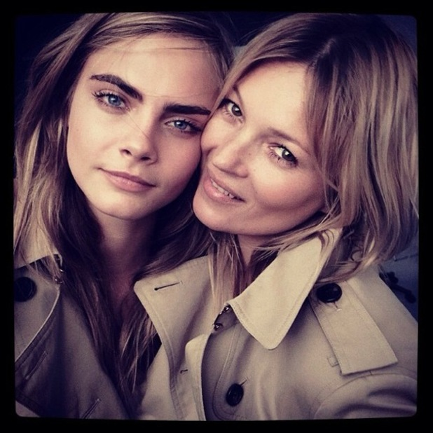 Cara Delevingne and Kate Moss pose for a behind-the-scenes snap while shooting a new Burberry fragrance campaign - 12 March 2014