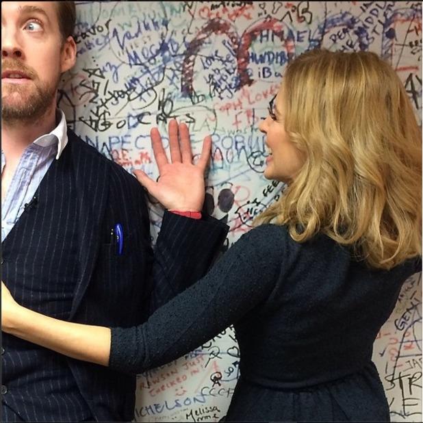 Kylie Minogue holding onto Ricky Wilson