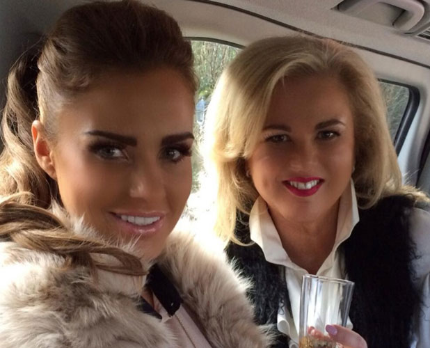 Katie Price on her way to Cheltenham Festival day 1 with a friend, 11 March 2014