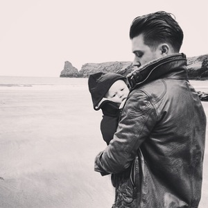 Union J's JJ Hamblett bonds with his baby son Princeton J. Alexander at the beach in Cornwall (17 March).
