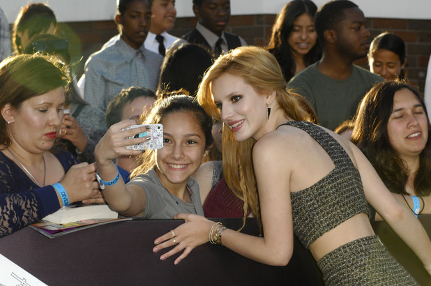 Bella Thorne steps out at the premiere of Divergent in Los Angeles, America - 18 March 2014