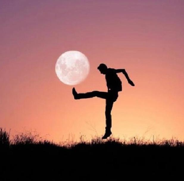 Man kicking the moon
