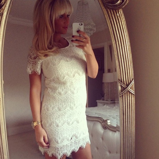 Pregnant Billie Faiers poses in white lace dress from Minnies Boutique, 19 March 2014