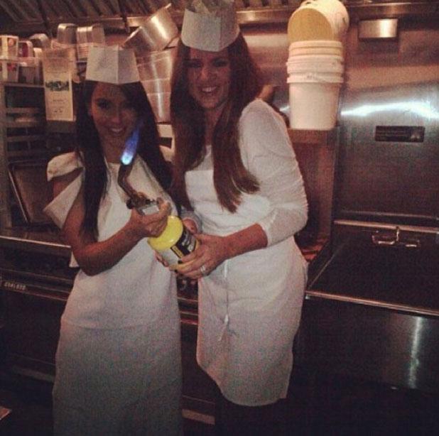 Kim Kardashian and Khloe Kardashian at a cooking class, 2012
