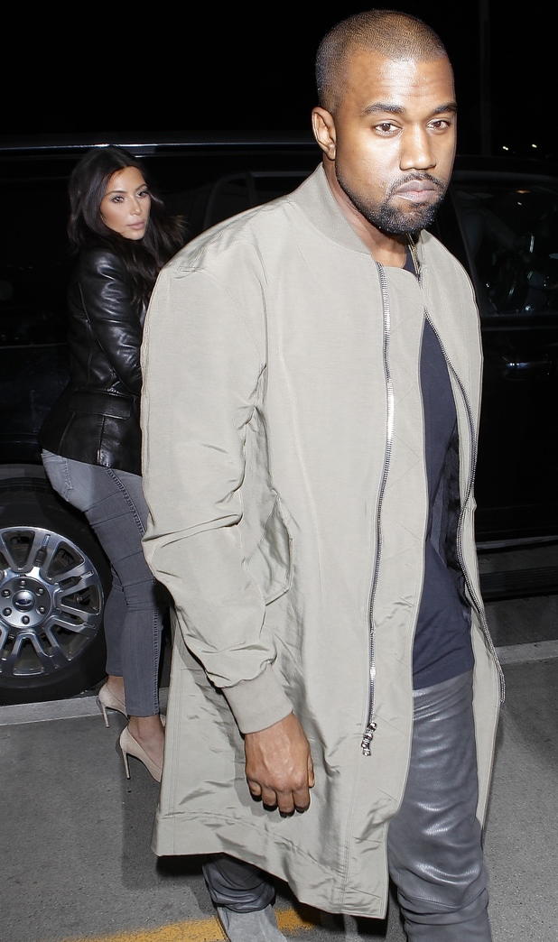 Kim Kardashian and Kanye West arrive at Los Angeles International Airport in America - 24 March 2014