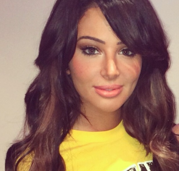 Tulisa shows off her new honey and brunette hair extensions, 12 March 2014