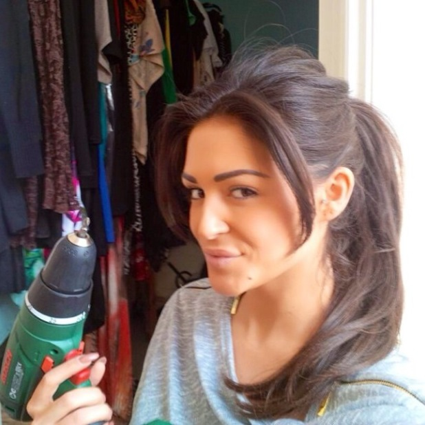 Casey Batchelor pictured with a power drill - 28 March 2014