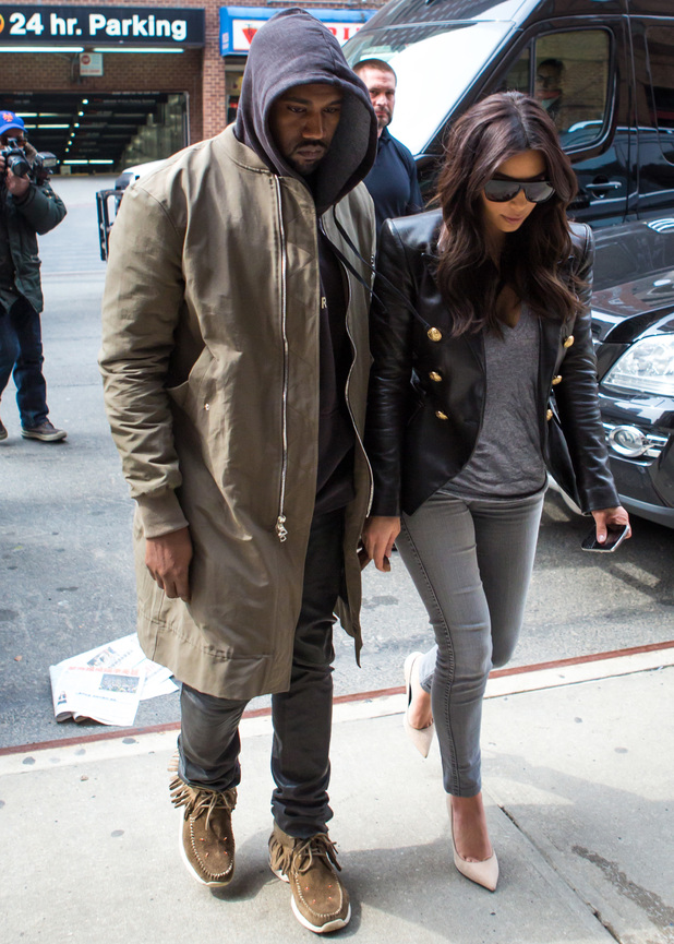 Kim Kardashian and Kanye West arriving at a hotel in Manhattan - 25 March 2014