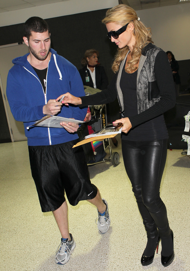 Paris Hilton arrives at Los Angeles International Airport, America - 22 March 2014