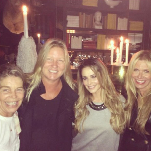 Cheryl Cole poses with friends while on holiday in South Africa, March 2014