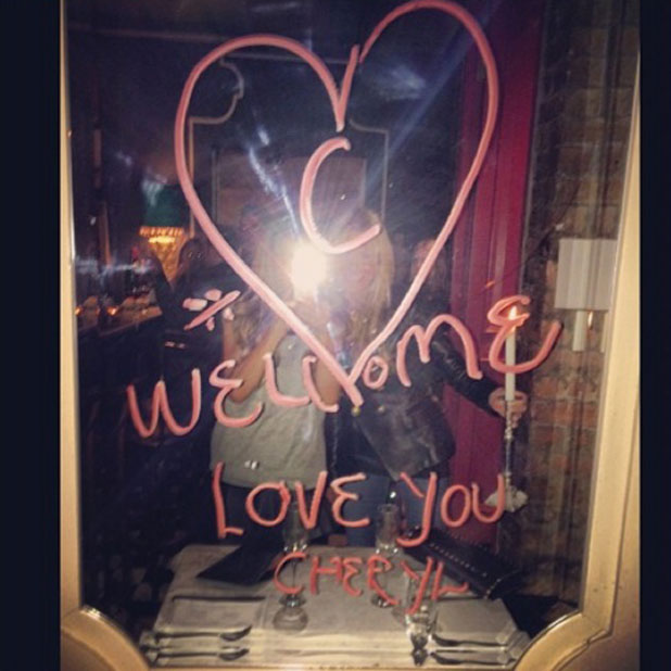 Cheryl Cole shares photo of message left on mirror in restaurant in South Africa, March 2014