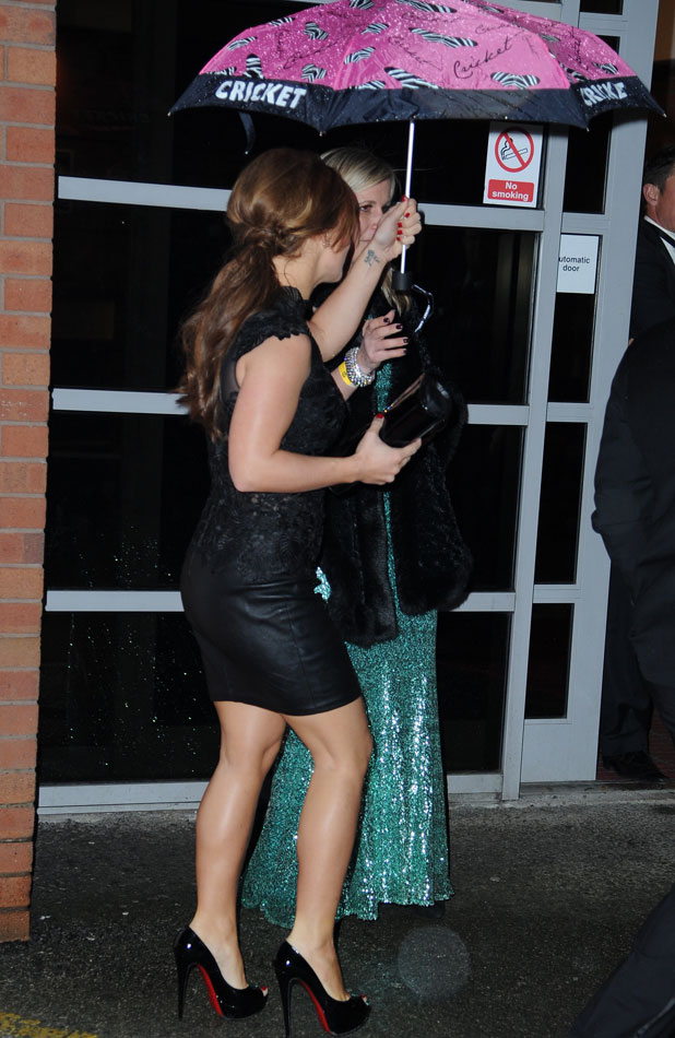 Coleen Rooney battles the rain arriving at Darren Fletcher and Lewis Mood's exclusive night of fundraising for Crohn's and Colitis, 27 March 2014