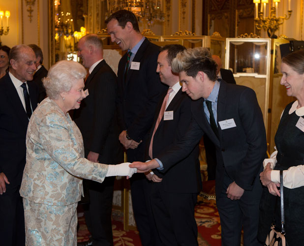 Queen Elizabeth II meets One Direction's Niall Horan at Buckingham Palace 25 Mar 2014
