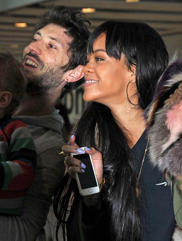 Rihanna takes selfie with a fan at Heathrow Airport, London, Britain - 24 Mar 2014