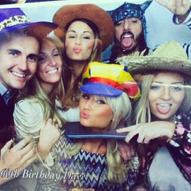 Billie Faiers and Sam Faiers play about in a photobooth at dad's 60th birthday, March 2014