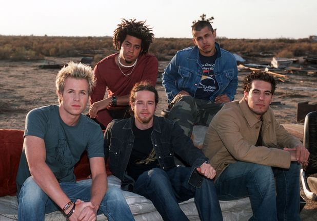 O-Town: Ashley Parker Angel, Dan Miller, Eric Michael Estrada, Trevor Penick and Jacob Underwood on the set of 'These Are The Days' video, Desert Palms, California Oct 2002