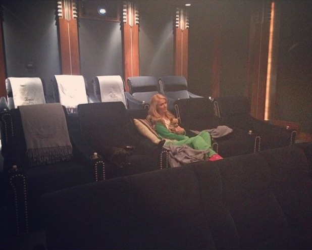 Paris Hilton shares picture of her chilled Friday night at her Dad's cinema room, 5 April 2015