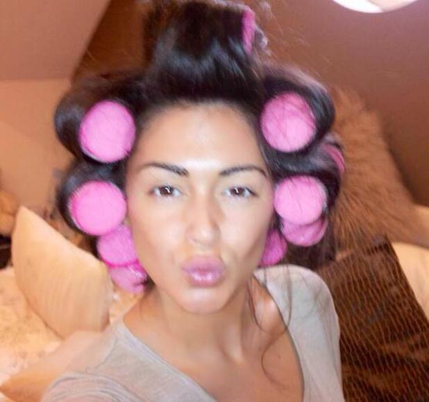 Casey Batchelor goes without make-up and wears hair rollers - 31 March 2014
