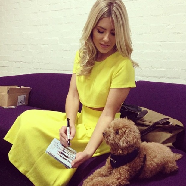 Mollie King wears a yellow two-piece by Miss Selfridge as she signs The Saturdays single sleeves - 10 March 2014