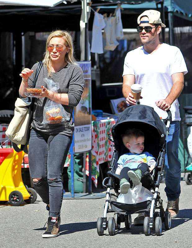 Hilary Duff and ex husband Mike Comrie spend time with their son Luca at a local Farmer's market in Beverly Hills, 31 March 2014