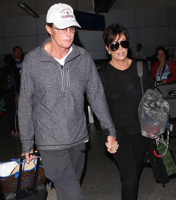 Bruce and Kris Jenner arrive at Los Angeles International Airport (LAX) holding hands, 2 April 2014