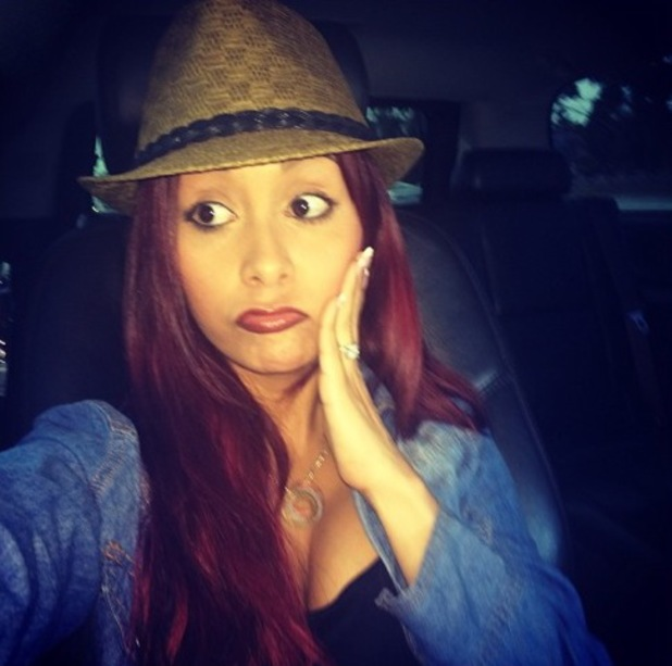 Snooki looks baffled in an Instagram picture saying she's confused why people pick fights with her online, 9 April 2014