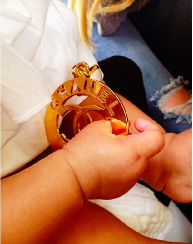 Khloe shares photo of baby North 'stealing' her Chanel earring