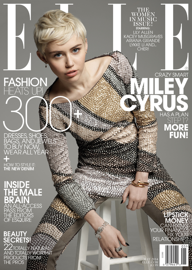 Miley Cyrus poses for the May issue of ELLE on sale 22 April 2014