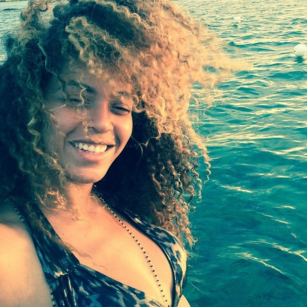 Beyonce posts make-up free photo of herself on a boat, Instagram, 8 April 2014