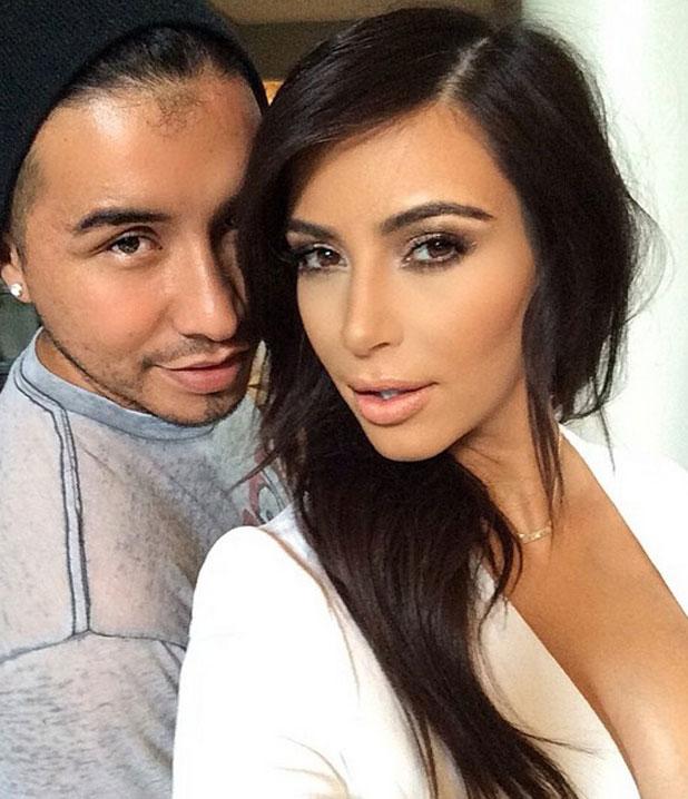 Kim Kardashian gets ready to attend the Ryan Seacrest Foundation party in LA on 10 April 2014