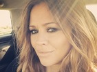 Pregnant Kimberley Walsh flaunts smoky eyes and effortless beachy waves